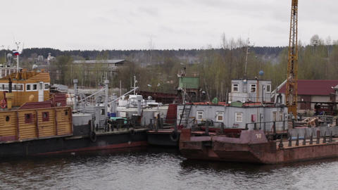 Old repair and freight ships at berth Stock Video Footage