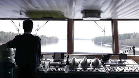 Navigation officer driving the ship on the river Footage