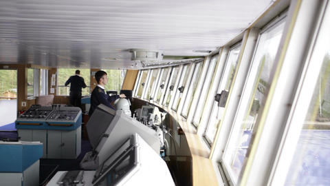 Navigation officer driving the cruise liner on the Live Action
