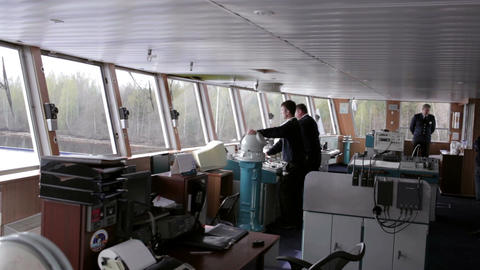 Navigation officer driving the cruise liner on the Footage