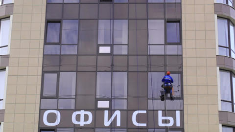 Man washes the windows of office building 2 Footage