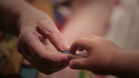 Grandma gives her grandson a candy. Macro shot Stock Video Footage