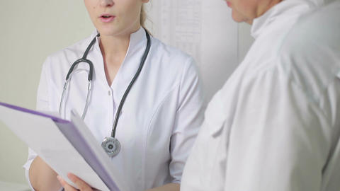 The nurse reported to the doctor about medical tes Stock Video Footage