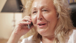 Middle-aged caucasian woman speaking on the mobile Footage