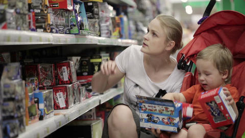 Mother and her two year old son are shopping for t Stock Video Footage
