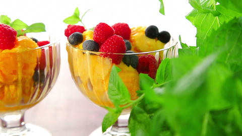 Orange ice cream with fruits - dolly shot Stock Video Footage