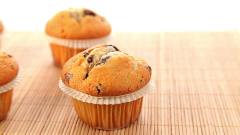 Fresh baked muffins with chocolate - dolly shot Stock Video Footage