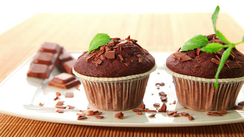 Chocolate muffins with chocolate - dolly shot Stock Video Footage