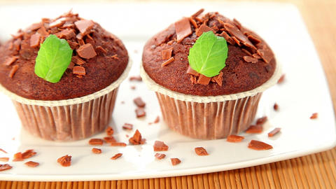 Muffin with chocolate on plate - dolly shot Stock Video Footage