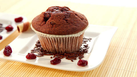 Two Delicious Muffins On Plates - Dolly Shot stock footage