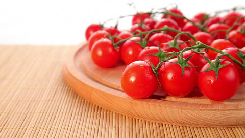Ripe cherry tomatoes on white background Stock Video Footage