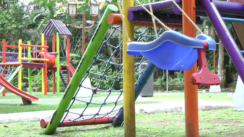 Empty single swing set. Missing of a son or daught Stock Video Footage