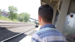 Man Waits for Train Stock Video Footage