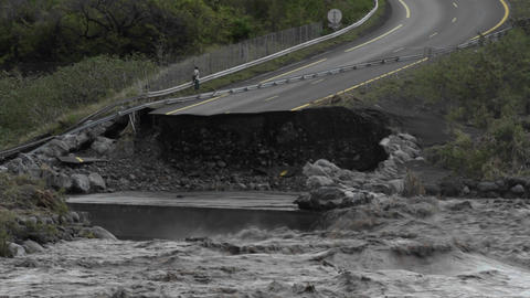 A flood washes away a highway Footage