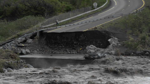 A flood washes away a highway Stock Video Footage