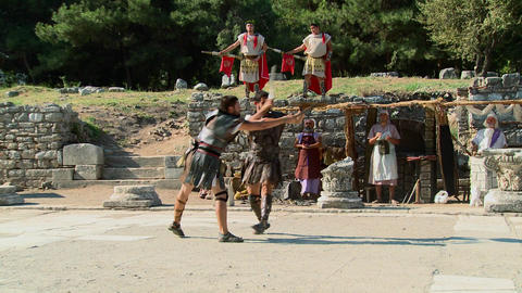Costumed actors reenact a Greek or Roman hand to h Stock Video Footage