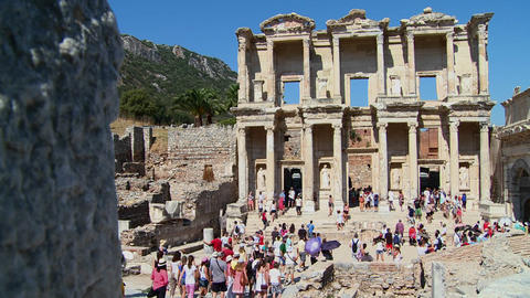 Tourists walk amongst the ruins at Ephesus, Turkey Stock Video Footage
