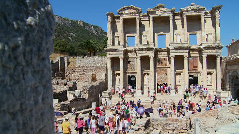 Tourists walk amongst the ruins at Ephesus, Turkey Footage