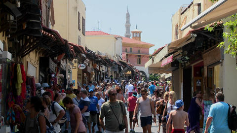 Tourists walk through the crowded streets of Rhode Stock Video Footage