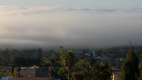 Fog rolls into neighbors in Southern California in Stock Video Footage
