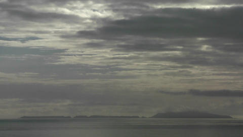 Dark storm clouds amass over the ocean Stock Video Footage