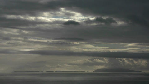 Dark storm clouds amass over the ocean Footage