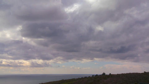 Storm clouds form over land and sea in this time l Stock Video Footage