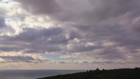 Storm clouds form over land and sea in this time l Footage