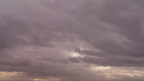 Many layers of storm clouds move in different dire Stock Video Footage