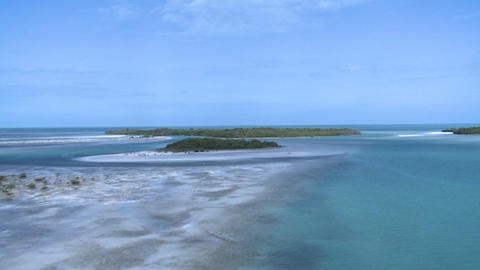 An aerial shot over a Caribbean lagoon Stock Video Footage