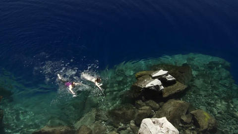People swim in the clear waters of Crater Lake, Or Footage
