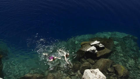 People swim in the clear waters of Crater Lake, Or Stock Video Footage