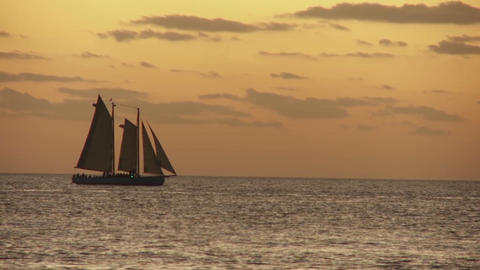 A beautiful sailing ship at sunset Stock Video Footage