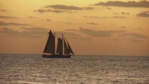 A beautiful sailing ship at sunset Footage