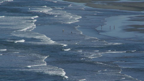 Ocean waves roll into a beach in Oregon or Norther Stock Video Footage