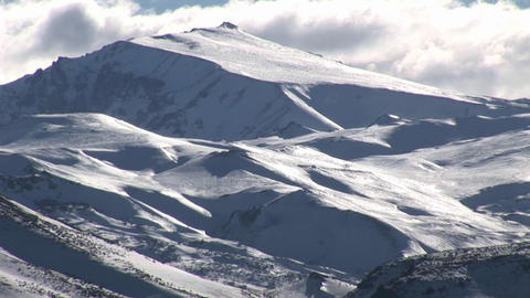 A snow covered mountain with clouds above Stock Video Footage