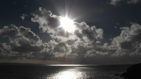 Beautiful clouds with the sun shining through Stock Video Footage