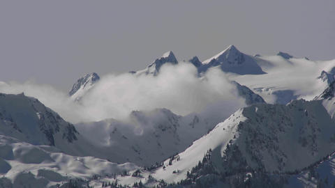 A time lapse shot of clouds over a snowy mountain Stock Video Footage