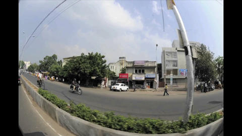 Dizzying fisheye time lapse of traffic on an India Stock Video Footage