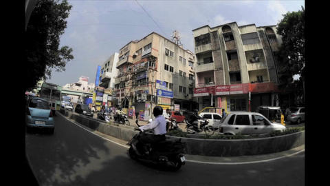 Dizzying fisheye time lapse of traffic on an India Footage