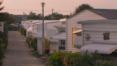 Rows of homes near a walking path at a trailer par Footage