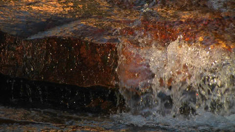 Water flows over rocks in a river at Tuolumne Mead Stock Video Footage