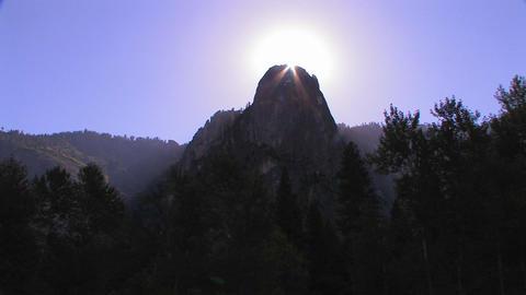The sun silhouettes a mountain peak in Yosemite Na Footage