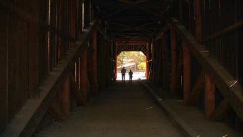 silhouette tunnel people wood walking construction Stock Video Footage