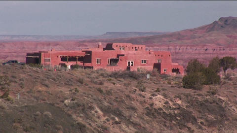 An adobe house occupies the desert in New Mexico Stock Video Footage