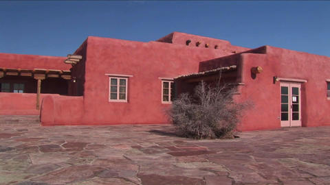 An adobe house occupies a desert plain in New Mexi Stock Video Footage