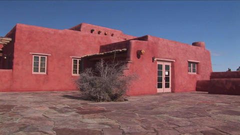 An adobe house occupies a desert plain in New Mexi Footage