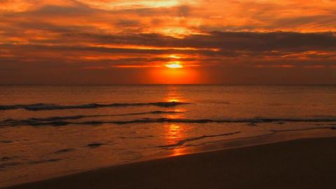 Beach waves slowly break during sunset Stock Video Footage