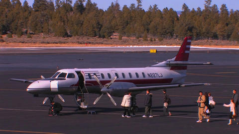 A group of passengers board a private jet Stock Video Footage