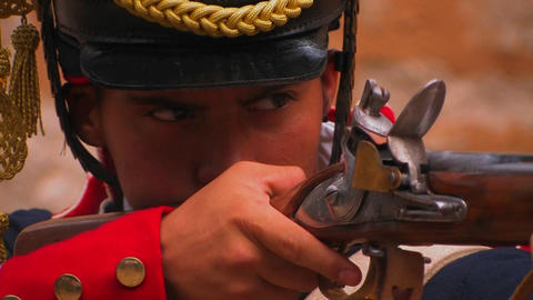 A soldier fires a musket at a reenactment of the B Stock Video Footage